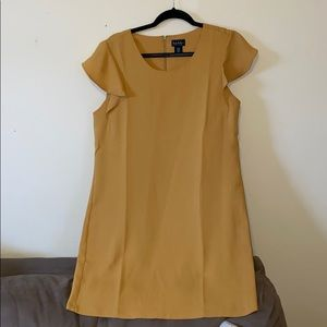 Nicole Miller: yellow dress with cap sleeves